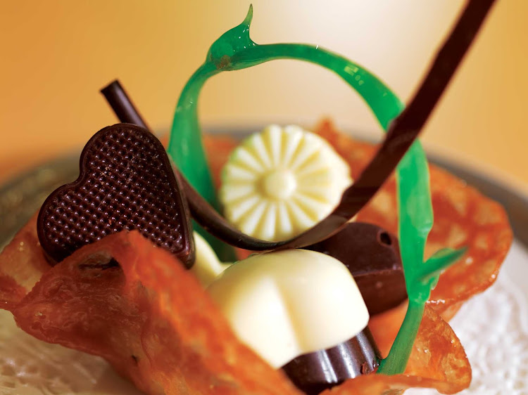 Treat yourself to a chocolate during dessert while dining at Grills aboard your Cunard ship.