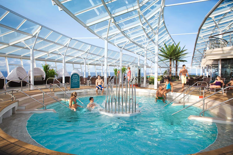 Take a dip in the refreshing waters of the Solarium's adults-only pool aboard Oasis of the Seas.