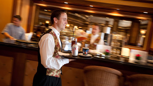 Culinary-Experiences-Bistro-Cafe-Waiter - Waiters provide solicitous service in the Bistro of the Crystal Symphony.