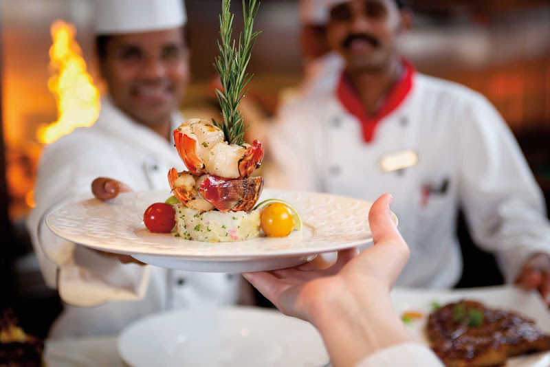 A lobster tail entrée prepared at Chefs Table during a Carnival cruise.