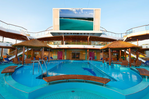 Carnival-Magic-Beach-Pool-Seaside-Theater-2 - Seaside Theater's large LED screen, positioned over Carnival Magic's Beach Pool, shows movies, concerts and sporting events.