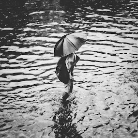when it rains by Mahmudul Alam Zisan - Black & White Portraits & People ( water, bangladesh, umbrella, 50mm, d3200, nikon, people, rain, dhaka )
