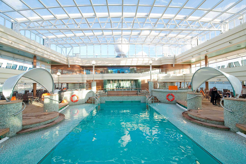 Guests can enjoy a dip in La Grotta Azzurra, MSC Magnifica's tranquil azure-colored indoor pool, during their cruise.