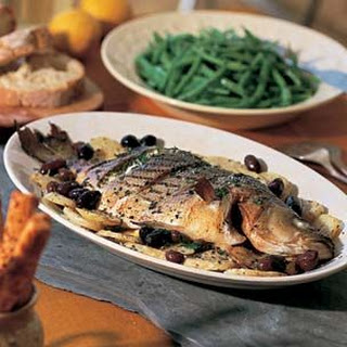 Sea Bass with Potatoes and Olives (Spigola al Forno)