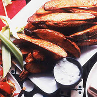 Buffalo Potato Wedges with Warm Blue Cheese Dip.