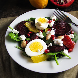 Roasted Beet and Spinach Salad with Goat Cheese, Eggs, Pomegranate, Orange, and Almond-Vinaigrette.
