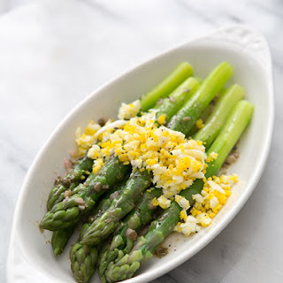 Boiled Asparagus with Sieved Eggs and Caper Vinaigrette.