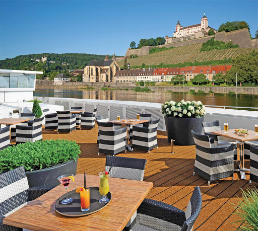 Balcony Cabin guests aboard Scenic enjoy magnificent views from spacious outdoor balconies, more than 20% larger than cabins of other river cruise ships.