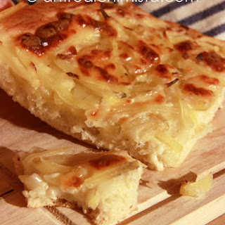 Focaccia Bread Topped with Potatoes, Onions, and Scamorza Cheese.