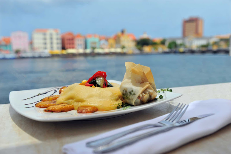 Keshi yena, gouda cheese stuffed with vegetables and meat or fish, is a favorite dish on Curacao with locals and tourists alike.