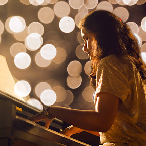 THe girl with the Piano by Ashish Garg - People Musicians & Entertainers