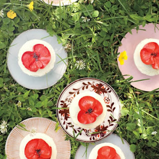 Orange-Poppy Seed Cupcakes with Buttercream Poppies.