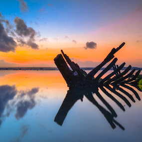 wreck .. by Nicholas Pinot oetomo - Landscapes Sunsets & Sunrises ( bali, skyline, skyscrapers, wreck, colors, boats, oranges, seascape, beach, skies, indonesia, sunshine, sunrise, landscapes )