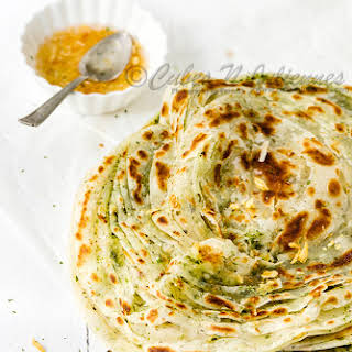 Multi-layered Flaky Flat Bread Flavored With Garlic And Mint.