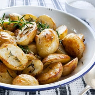 Roast New Potatoes With Garlic And Rosemary.