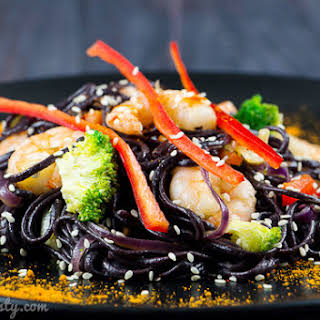 Spicy Black Rice Noodles With Shrimp And Vegetables.