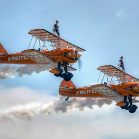 by Dave Byford - Transportation Airplanes ( clouds, air fete, wing walker, davebyford-photography.co.uk, wing walking, airashow, flight, flying, england, sky, duo, wings, aircraft, barnstormers, aerobatics, synchro )