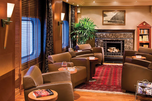 Regent-Seven-Seas-Voyager-Connoisseur-Club - Relax in the rich, traditional setting of the Connoisseur Club with a rare vintage Cognac in hand during your Seven Seas Voyager cruise.