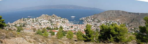 Hydra-Greece-panorama - A SeaDream ship stops for guests to visit the harbor of Hydra, Greece.