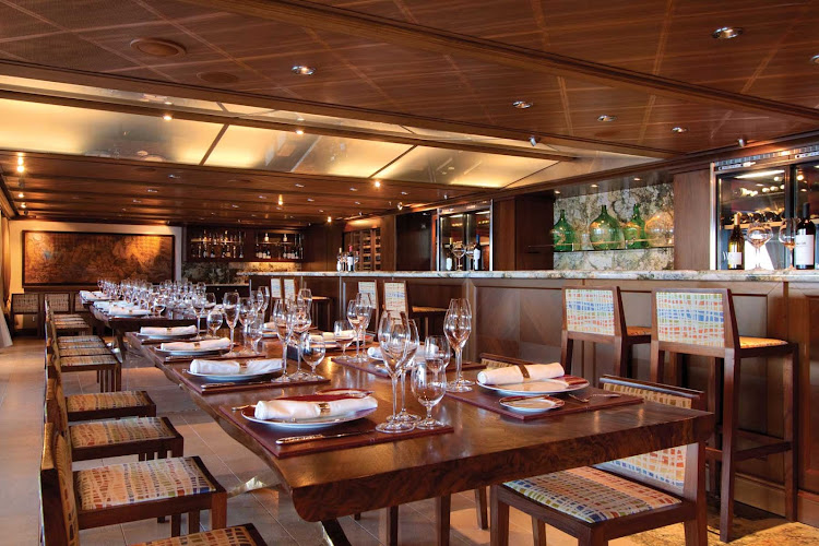 Make an exclusive booking at La Reserve restaurant by Wine Spectator on Oceania's Riviera to experience an elaborate dinner with hand selected wines in a private dining setting.
