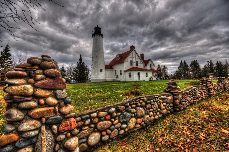 Iroquois Lighthouse in Michigan's Upper Peninsula by Marilyn Magnuson - Landscapes Cloud Formations ( wide angle, fall, stone fence, lighthouse, dark clouds )