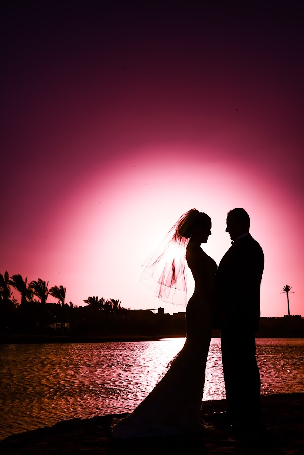 a bride and groom at sunset time. by Mohamed Basiouny - Wedding Bride & Groom