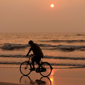 Peaceful transport by Srivenkata Subramanian - Landscapes Sunsets & Sunrises ( peaceful, sunset, silhouette, beach, bicycle, , Bicycle, Sport, Transportation, Cycle, Bike, ResourceMagazine, Outdoors, Exercise, Two Wheels )
