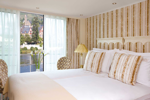 Uniworld-River-Beatrice-stateroom-window - Wake up in a comfortable stateroom with a picture-perfect view as you travel along the Danube River aboard the River Beatrice.