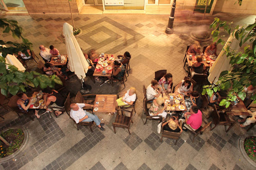 Tapas-Benidorm-Alicante-Spain - Locals and visitors in the coastal town of Beniform, in the province of Alicante, Spain, enjoy conversation and tapas, delicious small-plate dishes.