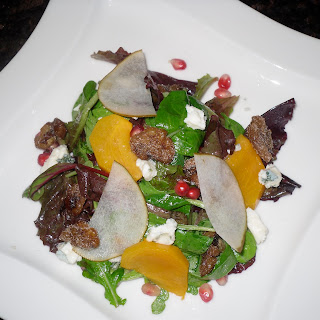 Poached Persimmon, Asian Pear, Pomegranate Salad with Blue Cheese and Spiced Candied Walnuts.