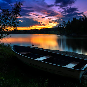 Parked For The Night by Lillian Molstad Andresen - Landscapes Sunsets & Sunrises ( bedrock, clouds, water, hills, may, 2014, grass, reflections, rock, lake, boat, landscape, rowboat, norway, hagatjern lake, sky, nature, nikon d800, sunset, trees, silhouettes,  )