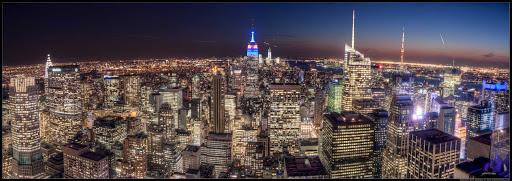 Manhattan-skyline-at-night - View of midtown Manhattan from atop Rockefeller Center.