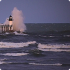 Lighthouse in Stormy Waves HD icon