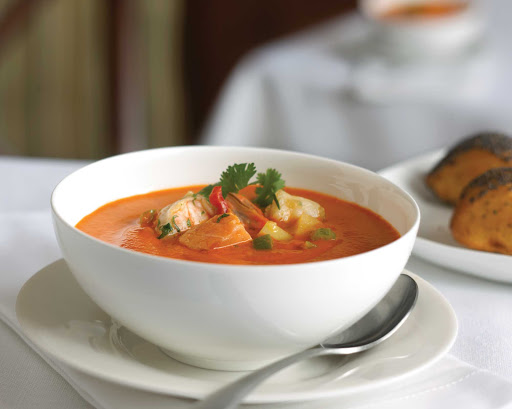 Royal-Caribbean-dining-fish-tomato-chowder - Fish and Tomato Chowder, a popular soup on Royal Caribbean voyages.