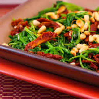 Sauteed Broccoli Rabe Recipe with Sun-Dried Tomatoes and Pine Nuts.