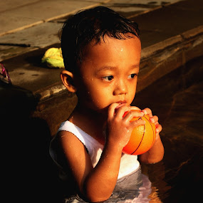 with ball by Christian Nugroho - Babies & Children Children Candids