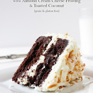 Flourless Chocolate Cake with Almond Frosting & Toasted Coconut.