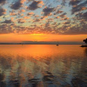 Indian River Lagoon Sunrise by Rich Eginton - Landscapes Sunsets & Sunrises ( orange, lagoon, indian river, sunrise, boat,  )