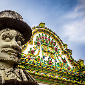 Thai Temple  by Amro Labib - Buildings & Architecture Places of Worship ( natural light, prayer, face, colorful, relax, simple, thailand, thai, architecture, wat, canon eos, bangkok, religion, colourful, sky, spiritual, pho, spirituality, light, wat pho, clouds, icon, patterns, colors, cloudscape, prey, scenic, relaxation, worship, portrait, cloud formations, temple, sculpture, statue, winter, pattern, simplicity, color, lines, palace, daylight, design, religious )