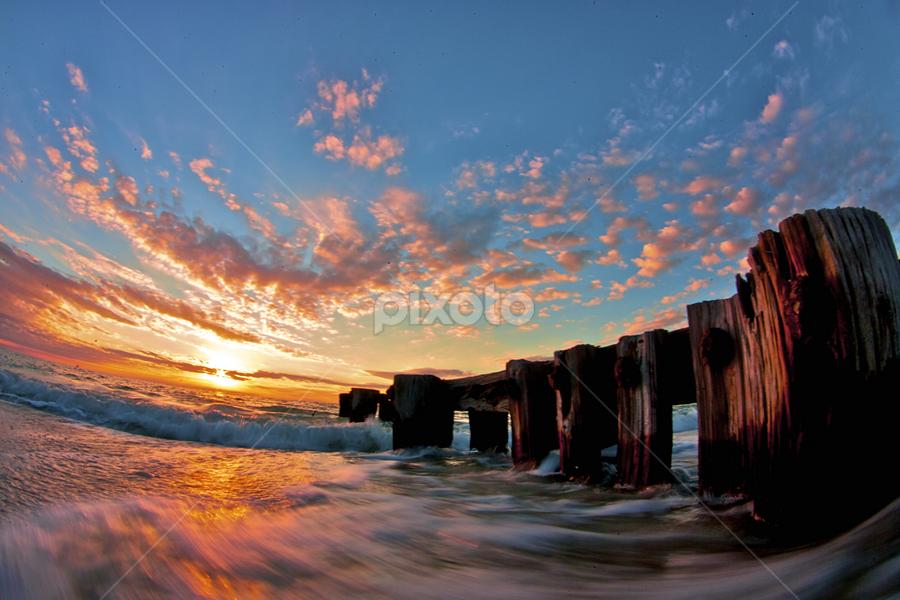 Waters motion by Chris Wilson - Landscapes Sunsets & Sunrises ( naples, florida, sunet, pier, ocean, groin, beach, gulf of mexico, seascape, landscape )