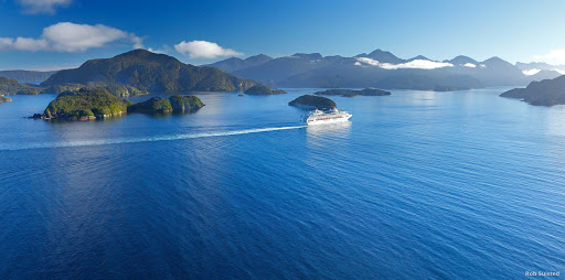 Cruise_a_World_Heritage_area - From a steamer chair on the Promenade Deck, take in the spectacular sights of Fiordland — which has has World Heritage status. You'll seeing the untouched scenery that impressed Captain Cook when he sailed into Fiordland more than 230 years ago.