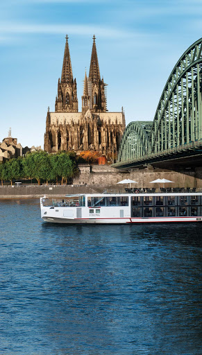 Viking-Longship-Cologne-Germany - Explore the classic architecture of Cologne, Germany, as you sail the Rhine under the famous Hohenzollern Bridge aboard the Viking Atla, Viking Jarl or Viking Tor.