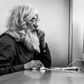 Human Vs Technology by Amro Labib - People Portraits of Men ( natural light, old, indoor, black and white, street, white, candid, portrait, street photography, pose, australia, beard, black, man, sydney )