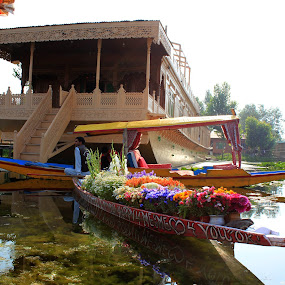 Flowers Transportation Business on water by Tarun Bhatnagar - Artistic Objects Business Objects ( water, device, transportation )