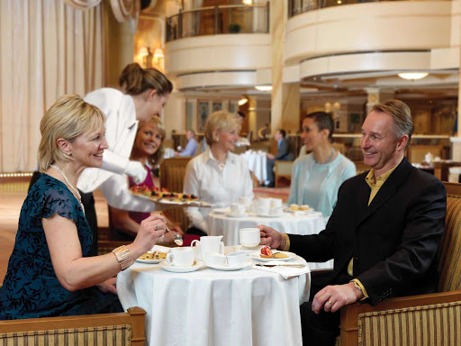 Have a warm cup of afternoon tea while listening to a live orchestra aboard Queen Victoria.