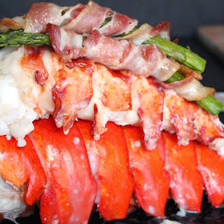 Lobster Tail with Bacon-Wrapped Asparagus.