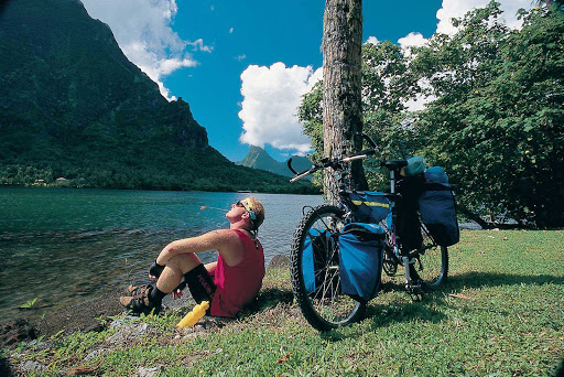 By biking on Mo'orea, you can choose your own path to see the island's sites.