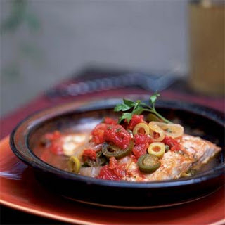 Filetes de Pescado a la Veracruzana (Fish Fillets Braised with Tomatoes, Capers, Olives, and Herbs).