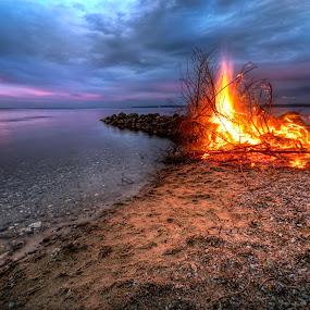 Bonfire by Bent Velling - Landscapes Beaches ( water, clouds, bonfire, samyang 14mm f2.8, sunset, vejle, beach, vejlefjord, denmark, sony a7r, rocks, fire )