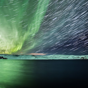First Star Trail of 2014 by Sigurður Brynjarsson - Landscapes Starscapes ( aurora borealis star trail northern lights sky dark lake reflect green mountain snow frozen cold night )